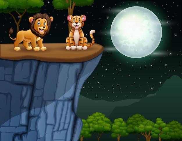Лев и тигр на скале
