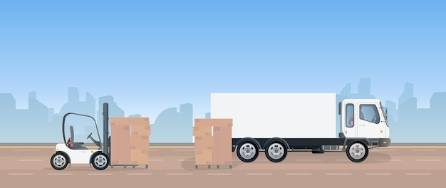 На дороге стоит грузовик и поддон с картонными коробками.