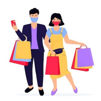 코로나바이러스 전염병 동안 쇼핑백을 든 남녀가 보호용 안면 마스크를 착용합니다. 검은 금요일.