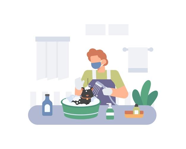 한 남자가 목욕을하고 물과 비누로 고양이를 청소하여 코로나 바이러스 일러스트를 죽입니다.