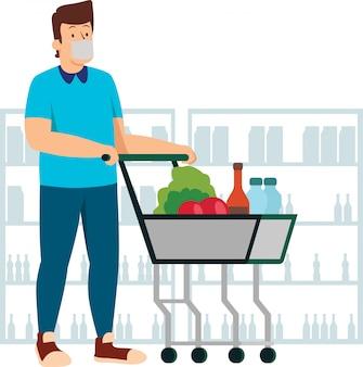 Человек, делающий покупки в магазине во время нового нормального, продолжая использовать медицинскую маску