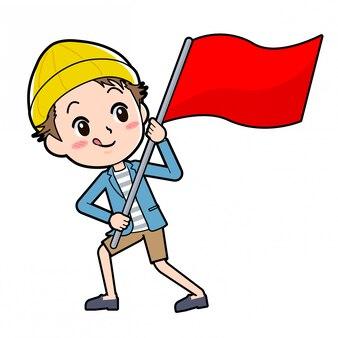ジャケットとショートパンツの男性が赤い旗を掲げています。