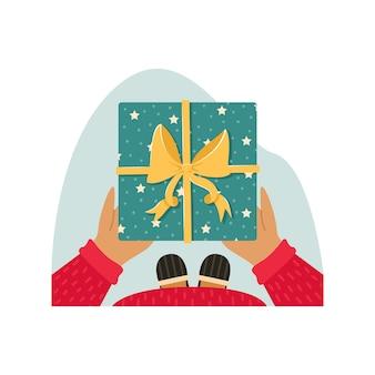 Мужчина в пижаме и тапочках держит в руках рождественский подарок. новогодняя иллюстрация