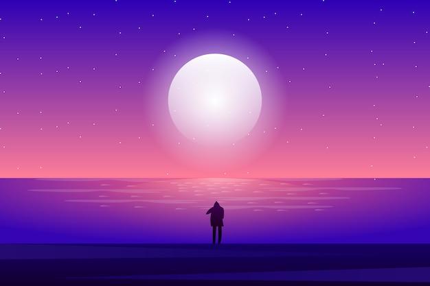 Мужчина смотрит на море и звездную ночь