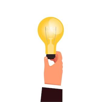 남자의 손에 빛나는 전구가 있습니다. 사업가에서 사업 아이디어와 창의력을 생성하는 개념. 평면 만화. 흰색 배경에 고립.