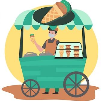 Мужчина продает мороженое в торговце мороженым, продолжая пользоваться медицинской маской