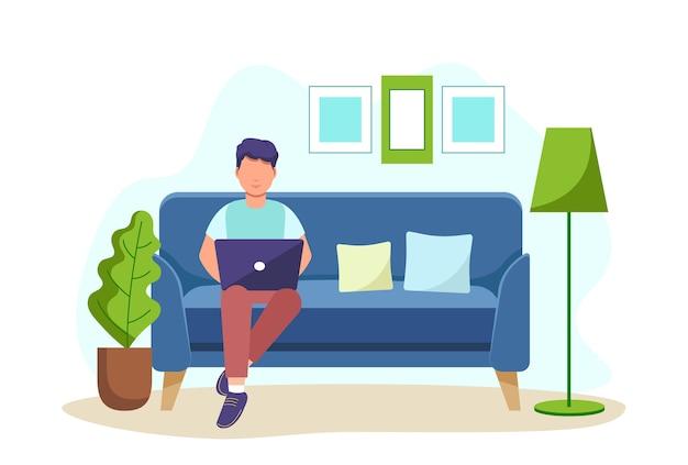 Мужчина сидит на диване с ноутбуком и работает из дома. студент или фрилансер