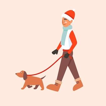 Мужчина выгуливает собаку зимой в теплой одежде и зимних сапогах