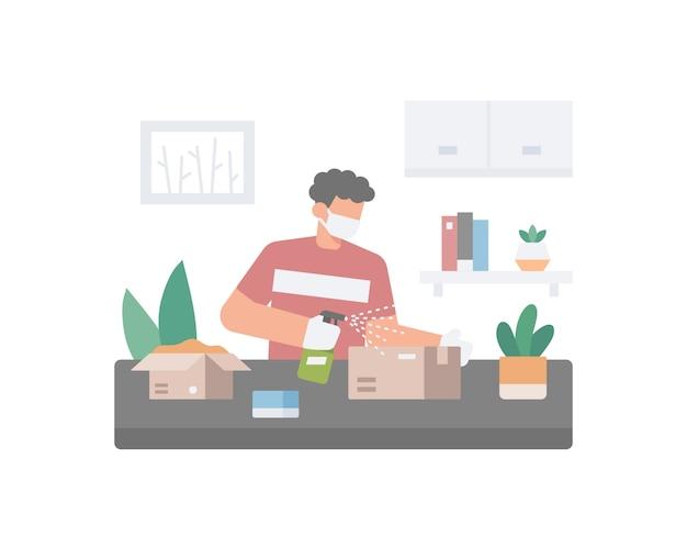 Мужчина носит маску для лица и чистит коробку или упаковку с помощью дезинфицирующего распылителя.