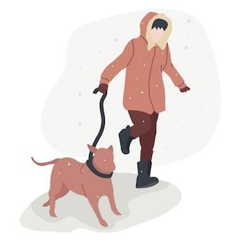 겨울에 애완견과 놀고 재킷을 입고 남자.