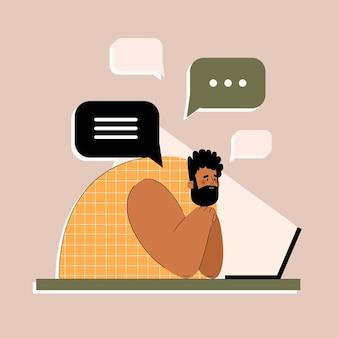 Мужчина с ноутбуком пишет текстовые сообщения и учится в интернете