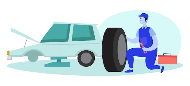 Механик ремонтирует сломанную автомобильную шину