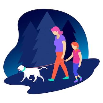 子供を持つ母親がペットの犬を連れて歩き回る