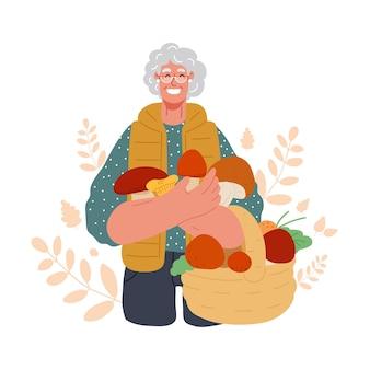 가을철에 수확한 버섯을 바구니에 들고 서 있는 노부인