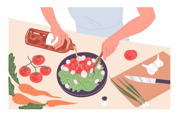 사람은 집에서 식사를 요리합니다. 신선한 야채 샐러드.