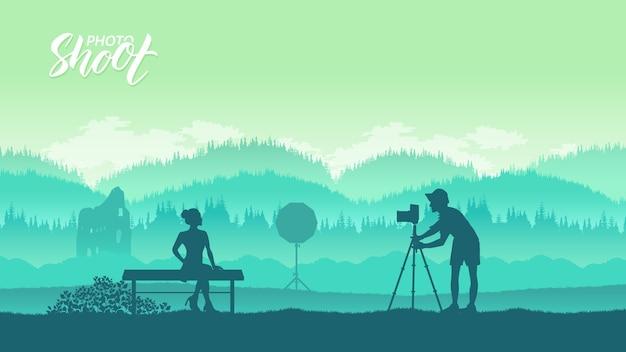 機材を持った写真家が自然界のモデルとフォトセッションを行う