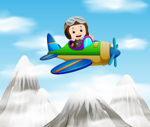 Пилот на самолете над горой