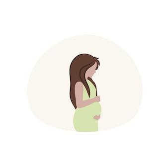 妊娠中の女の子は、赤ちゃんが生まれるのを待っている間、彼女の手で彼女の大きなお腹を保持します