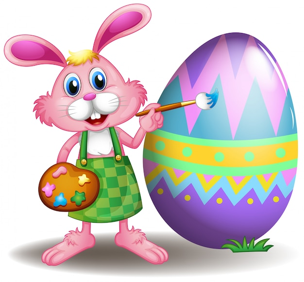イースターエッグを描くウサギ