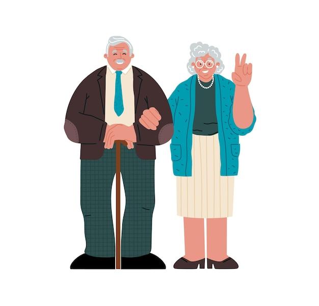 白い背景の上に一緒に立っている年配のカップル祖母は手で平和のサインを作る