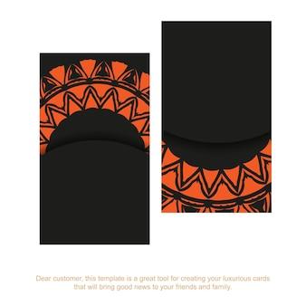 Набор визиток черного цвета с оранжевым орнаментом. готовый к печати дизайн визитной карточки с местом для текста и винтажными узорами.