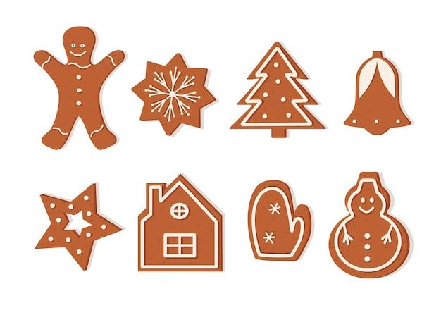 さまざまな形のクリスマスジンジャーブレッドクッキーのセット。おいしいお正月デザート、アイシング付きのお祝いカーリークッキー。