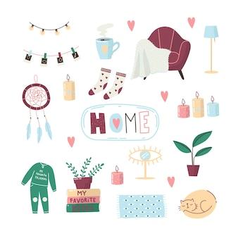 집에 아늑한 물건 세트. 아늑한 집. 가정의 편안함을위한 것들. 드림 캐쳐, 양말, 잠옷, 잠자는 고양이, 커피, 안락 의자, 양초.