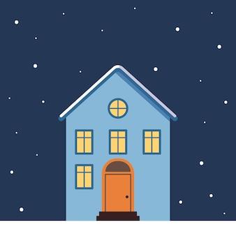 눈 속의 밝은 지붕, 창문의 빛, 눈송이가 있는 작은 집
