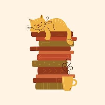 眠っている猫と熱いお茶のカップと本のスタック。本の山で寝ているかわいい子猫。