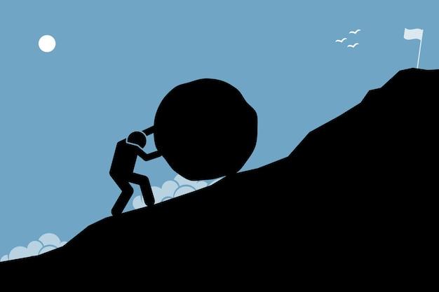 Сильный мужчина толкает большой камень в гору, чтобы достичь цели на вершине. произведение, изображающее тяжелую работу, задачи, миссию и достижения.