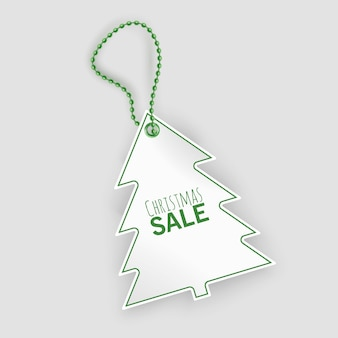 白い背景の上のクリスマスツリーの形のクリスマスセールタグのタグ