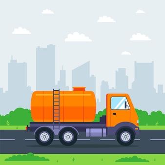 タンクローリーが街を背景に街を駆け抜けます。液体貨物の輸送。