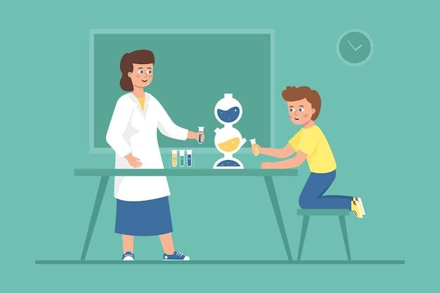 先生と子供が一緒に化学実験をします。学校の研究室での科学テスト。