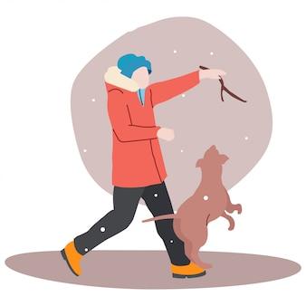 한 겨울에 한 십대가 강아지와 놀고있다.
