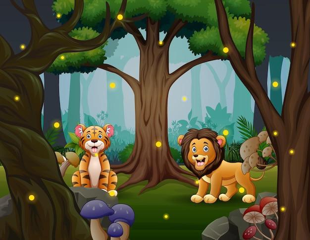Тигр и лев играют в красивом лесу Premium векторы