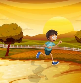 어린 소년이 달리는 오후의 모습