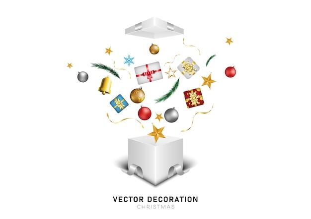 Открылась белая подарочная коробка со звездами, колокольчиками и елочными шарами