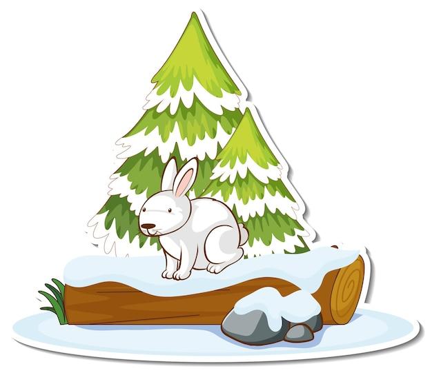 雪のステッカーで覆われた松の木と白いウサギ