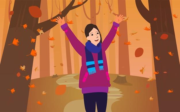 ウッズやパークの真ん中で秋の季節を楽しむ女性