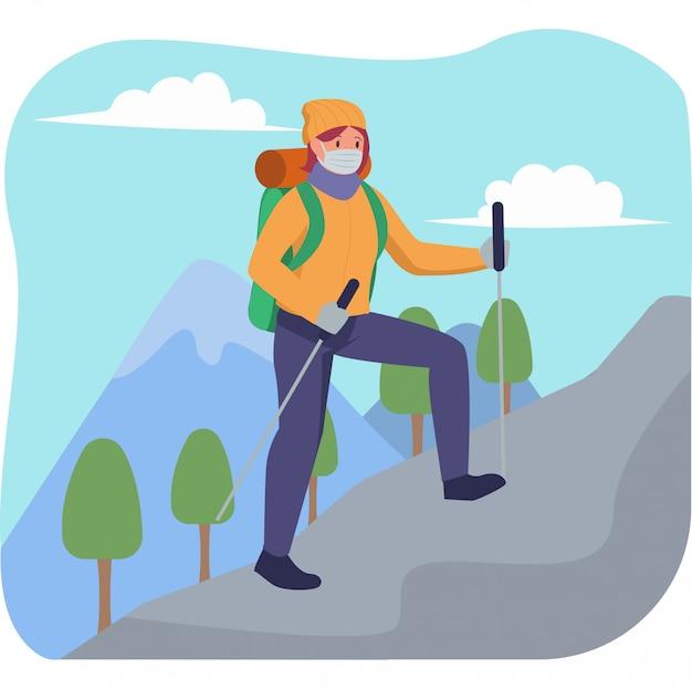 医療用マスクを使い続けながら一人でハイキングする女性