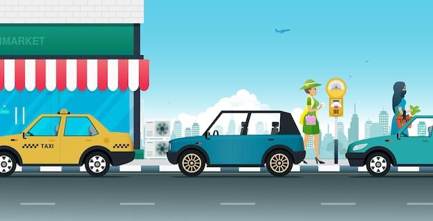 Женщина использует паркомат, чтобы припарковаться на обочине дороги.