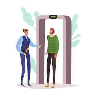 女性が金属探知機を通過します。空港のチェックポイント。