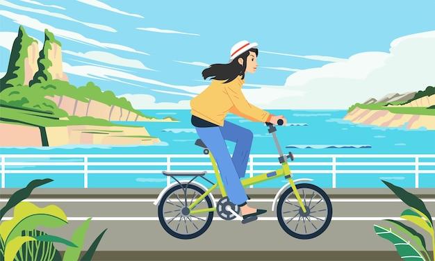 한 여성이 아름다운 바다 풍경 삽화와 함께 해변 도로를 따라 자전거를 탄다