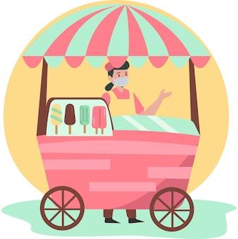Женщина продает фруктовое мороженое у торговца фруктовым мороженым, продолжая использовать медицинскую маску