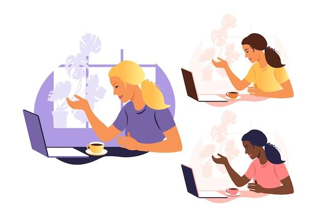 Женщина работает и общается на портативном компьютере, сидя за столом дома с чашкой кофе и бумагами
