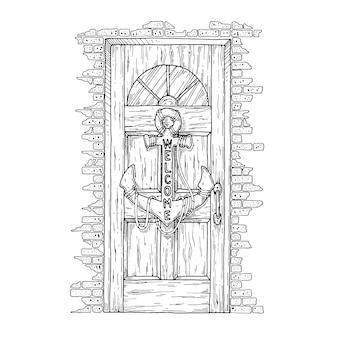 Деревянная дверь с висящим на ней якорем.