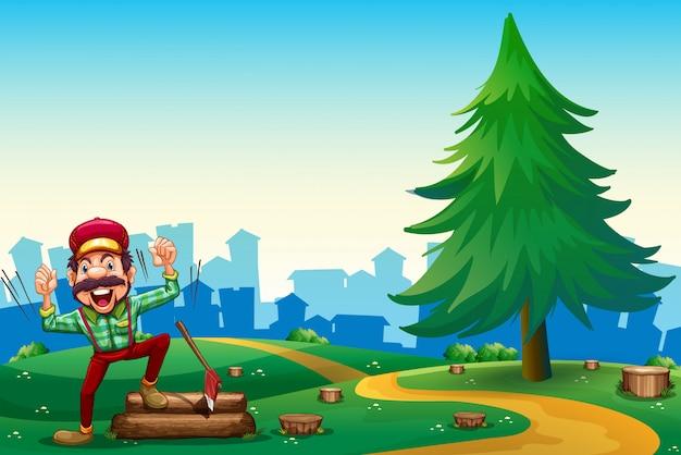 Лесник рубит дрова на вершине холма возле сосны