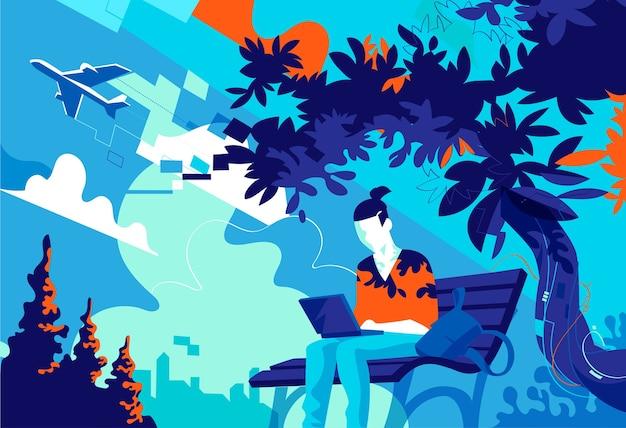노트북에서 일하는 공원 벤치에 앉아 어린 소년
