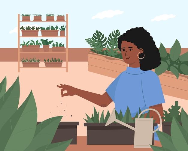 Молодая милая женщина выращивает растения на террасе. модный эко-сад на крыльце.