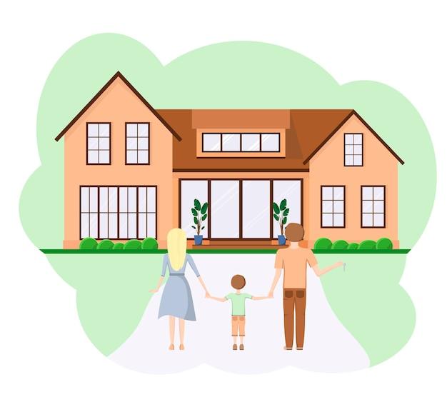 新しい家を背景にした若い家族